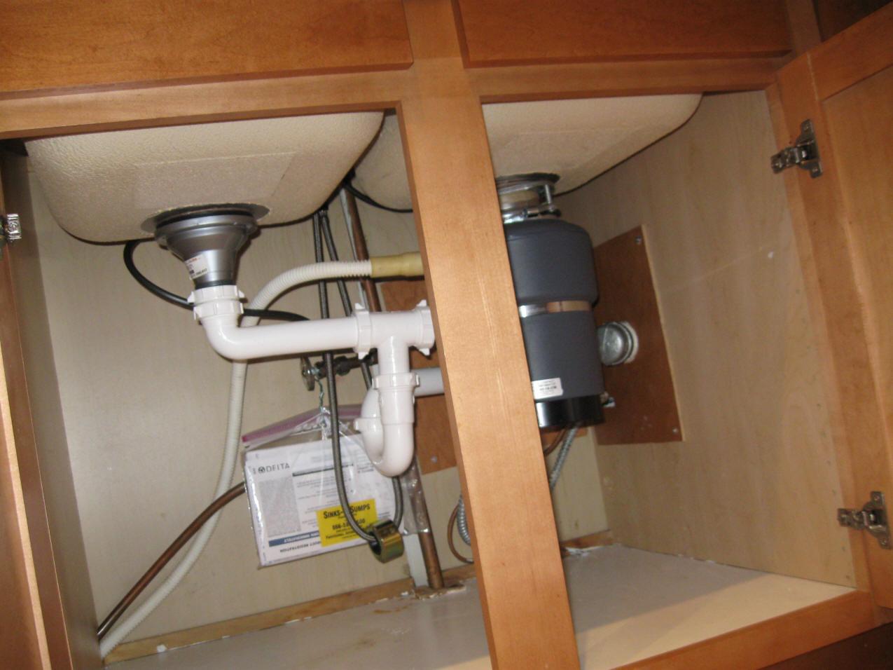 water leaking under kitchen sink cabinet replacing a kitchen sink Under Kitchen Sink Leak Zitzat